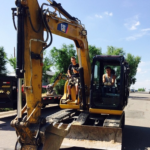 Best Plumbing of Denver Boys on the Excavator